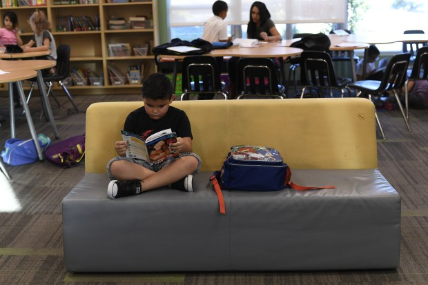 COMMERCE CITY, CO - OCTOBER 26: Season to Share story is about a literacy program called Accelerated Reader, which tasks kids with reading books and taking tests for points. Kevin Salinas 7 years old sits on the couch to read a book October 26, 2016 at the Suncor Boys & Girls Club. (Photo By John Leyba/The Denver Post)